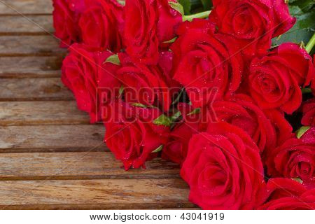 bouquet of red roses with water drops