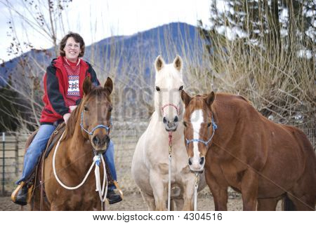 Smiling Lady With Her Horses