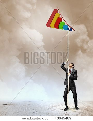 Image of businessman climbing rope attached to graph aloft