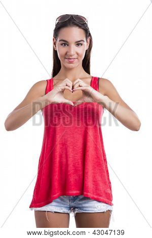 Beautiful woman making a heart symbol with her hands, isolated on white background