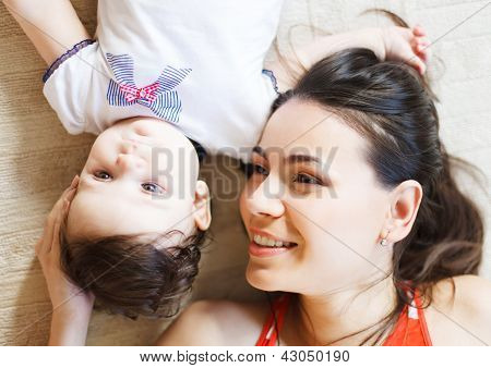 Mother With Eight Month Old Baby Girl Indoor