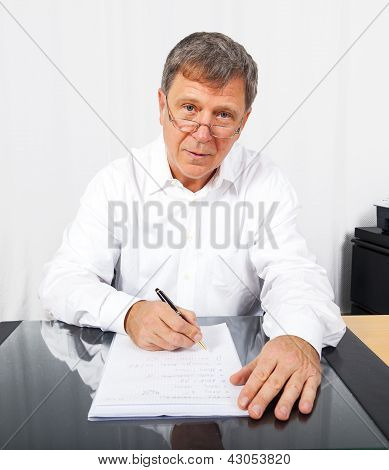 business man in office at his desk