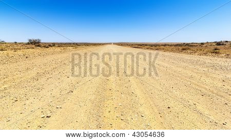 An image of a desert road to the horizon