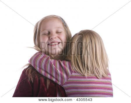 Little Sister Hugs Big Sis