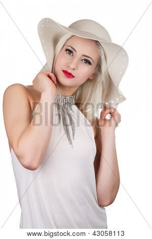 Beautiful young woman with diamond necklace and a hat, isolated on white
