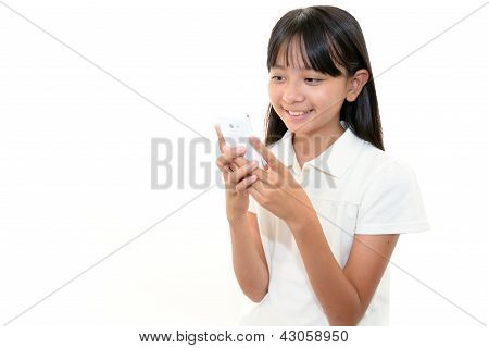 Happy young girl holding mobile phone