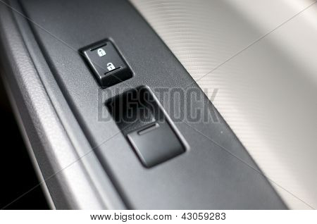 Close up detail of window control button inside a car
