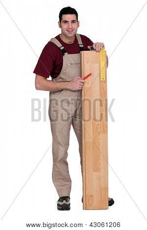 portrait of carpenter laying parquet
