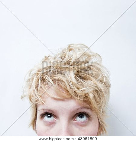 Tired Blond Girl Looking Up