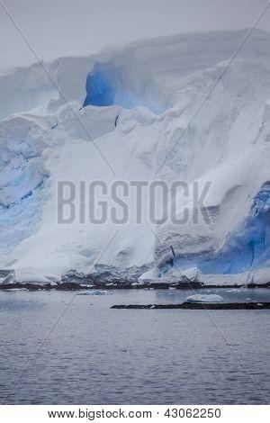 Antarctic Iceberg With Blue Cavern