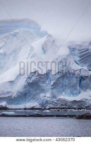 Antarctic Iceberg In The Mist