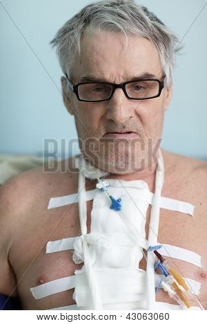 Senior Man With Bandage On Chest