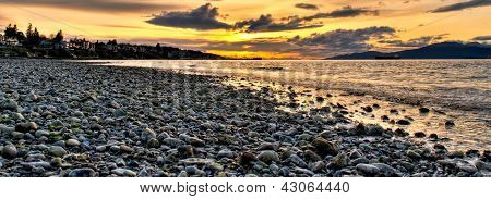 Panoramic Pebble Beach With Orange Sunset