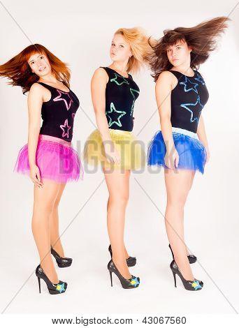 Three pretty girls dancing