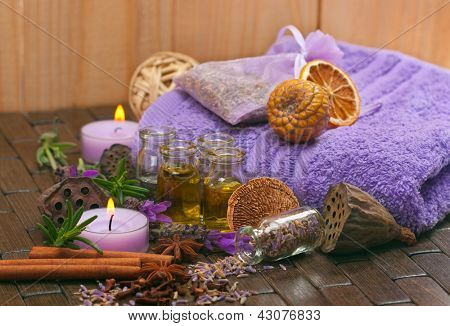 Spa concept with lavender, massage oil, aromatherapy items