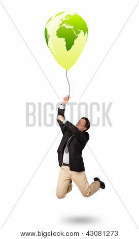 Handsome young man holding a green globe balloon