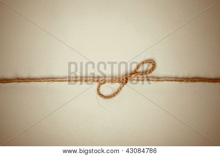 Closeup of braided twine tied in a bow knot