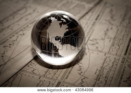 Globe With Financial Papers