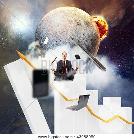 Businessman sitting on bars in lotus flower position against space background with office stuff aloft