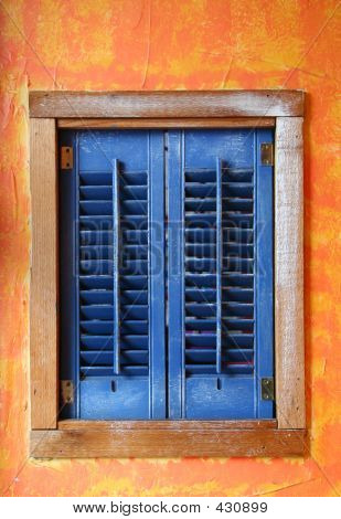 Blue Shutter On Orange Wall