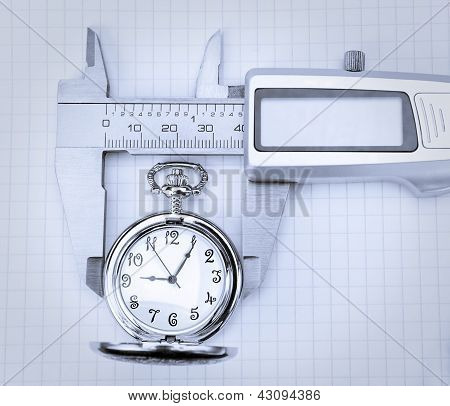 Concept Image Of A Pocket Watch And Trammel.