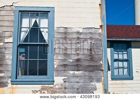 Weathered House And Windows