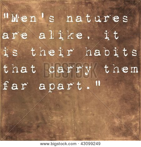 Inspirational quote by Confucius on earthy brown background