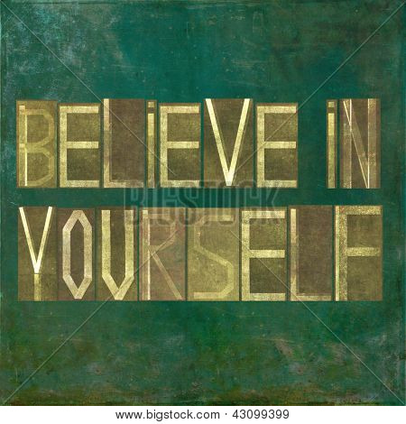 "Earthy background image and design element depicting the words ""Believe in yourself"""