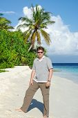 Young Man On White Sand Beach On Maldives