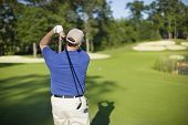 Golfer Hitting Onto Defocused Green
