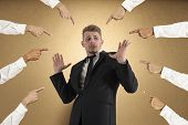 picture of strangle  - Concept of accused businessman with fingers pointing - JPG