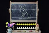 foto of dust bunny  - Easter Rabbit sketch on vintage blackboard over black - JPG