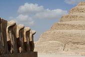 stock photo of king cobra  - alley of cobras in front of saqqara step pyramid - JPG