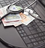 picture of lobbyist  - Stethoscope and money lying on the keyboard - JPG