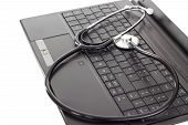 foto of lobbyist  - A black stethoscope lying on the keyboard - JPG