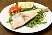 stock photo of swordfish  - roasted swordfish with lemon salad and tomatoes on wooden background - JPG