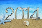 stock photo of cockle shell  - New year 2014 on the beach - JPG