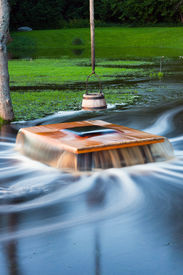 picture of shadoof  - Old flooding well and a sweep or shadoof with timber bucket at golden sunlight - JPG