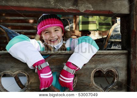 Winter, child, apres ski - young girl enjoying winter vacation