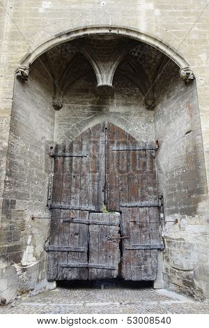 Main entry wooden gate of the Papal Palace in Avignon,France