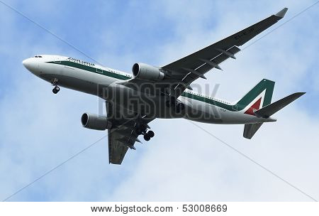 Alitalia Airbus A330 in New York sky before landing at JFK Airport