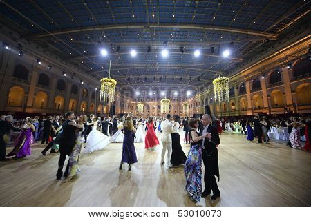 MOSCOW - MAY 25: Different couples whirling in the dance under purple lights  at 11th Viennese Ball in Gostiny Dvor on May 25, 2013 in Moscow, Russia.