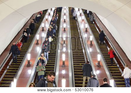 MOSCOW - FEB 28: People go on the escalator in the Moscow metro on February 28, 2013 in Moscow, Russia.