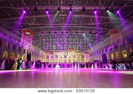 MOSCOW - MAY 25: Beautiful people under purple lights at 11th Viennese Ball in Gostiny Dvor on May 25, 2013 in Moscow, Russia.