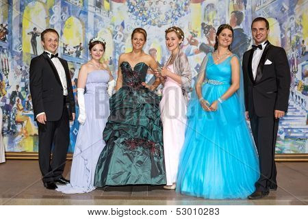 MOSCOW - MAY 25: Three beautiful couples at 11th Viennese Ball in Gostiny Dvor on May 25, 2013 in Moscow, Russia.