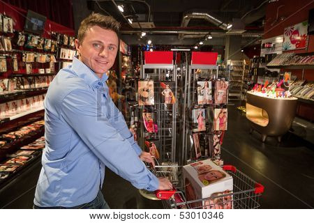 MOSCOW - JAN 24: A man with a box in the cart in the Store in a museum of erotica Point G on January 24, 2013 in Moscow, Russia.