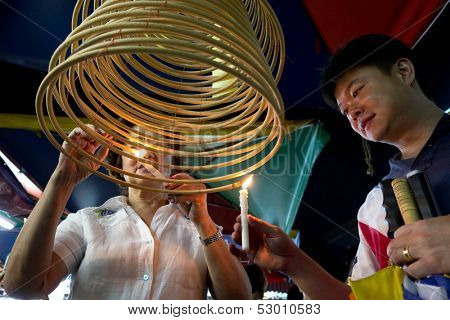 AMPANG - OCTOBER 9: Devotees of the Buddhism and Taoism faith light up the circular joss-sticks at the Kau Ong Yah Temple in Ampang, Malaysia during the Nine Emperor Gods festival on October 9, 2013.