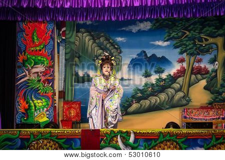 AMPANG - OCTOBER 9: A Chinese Opera actress performs on stage at the Kau Ong Yah Temple in Ampang, Malaysia on October 9, 2013. This performance is part of the nine emperor gods festival celebrations.