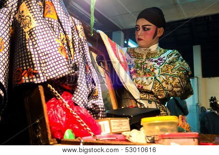 AMPANG - OCTOBER 9: A Chinese Opera actress lays out her costume change before her act at the Kau Ong Yah Temple in Ampang, Malaysia on October 9, 2013; celebrating the nine emperor gods festival.
