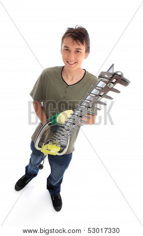Smiling Young Male With Garden Tool